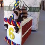 сувенир кусочек торта с енотом